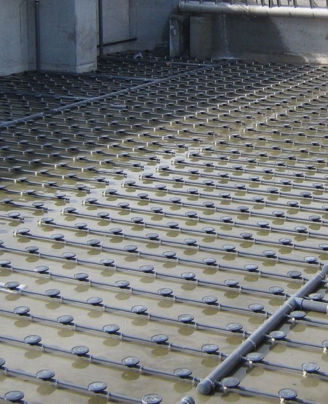 Disc diffuser aeration system installation at municipal WWTP
